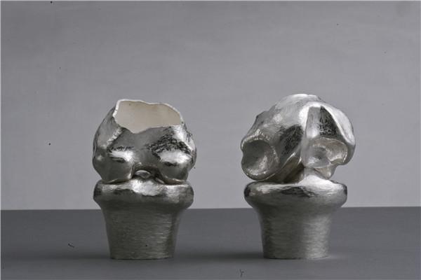 作者:王克震     作品:骨器       尺寸:10 x 10 x 20cm    材质:银.jpg